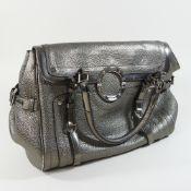 A Versace metallic silver effect leather designer handbag,