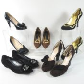 A pair of Prada brown leather high heeled shoes, with gilt buckles, size 36.