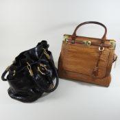 A Michael Kors light brown crocodile skin handbag, together with a Michael Kors dark brown handbag,