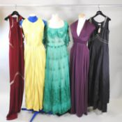 A Frank Usher green dress with a net skirt, together with a Jean Patou yellow dress,