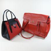 A Michael Kors red and black leather handbag, 27cm,