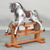 A small Haddon painted wooden rocking horse,