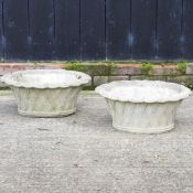 A pair of reconstituted stone planters, in the form of baskets,