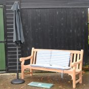 A hardwood garden bench, with blue and white striped loose cushions, and cover, 183cm,
