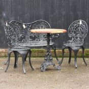 A black painted garden bench, 102cm, together with a pair of chairs,