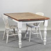 A pine and white painted dining table, 152 x 92cm,