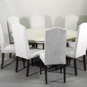 A set of eight cream upholstered high back dining chairs,