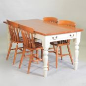 A pine kitchen table on a white painted base, containing a single drawer,160 x 85cm,
