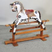 A mid 20th century painted wooden rocking horse,