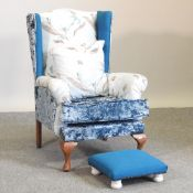 A George III style blue upholstered wing armchair,