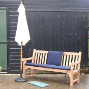 A teak garden bench, with blue loose cushions, and cover, 183cm,