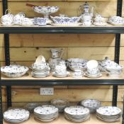 An extensive early 20th century Royal Copenhagen blue fluted full lace porcelain matched part