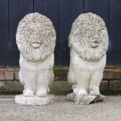 A pair of reconstituted stone gatepost finials, in the form of lions,