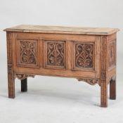 An early 20th century stripped oak coffer,