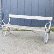 A hardwood and wrought iron garden bench,