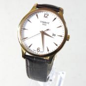 A Tissot gentleman's wristwatch, on a brown leather strap,