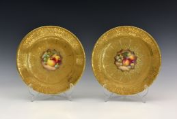 Two Royal Worcester 'Fruit' gilded porcelain cabinet plates, each with indistinct signatures,