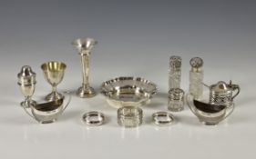 A collection of silver smalls, comprising of three cut glass perfume / scent bottles with silver