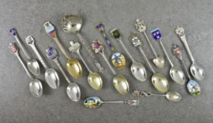 A small collection of silver and enamel souvenir spoons, comprising a Guernsey spoon by Kenneth