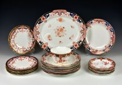 A large collection of Royal Crown Derby dinnerware, of varying patterns in the Imari palette,