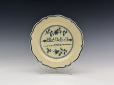 A George III Staffordshire creamware plate, with shaped rim, painted with the inscription 'Elizh,