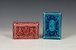 Two 19th century Minton Hollins & Co pottery tile paperweights, both of rectangular form with