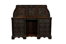 A Victorian carved oak side cabinet, made using some earlier elements, the shaped three panel back