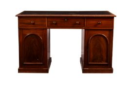 A Victorian mahogany desk, the moulded top with later rexine writing surface, over three frieze