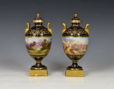 A fine pair of Coalport porcelain urn shaped vases with covers, early 20th century, of typical