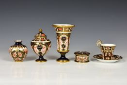 A collection of Imari pattern Royal Crown Derby, comprising a vase and cover, two further vases, a
