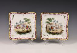 A pair of 19th century Continental porcelain plates, imitating enamel, of wavy edge and ribbed