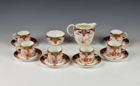 A set six Crown Derby Imari pattern coffee cans & saucers with milk jug and sugar bowl, pattern