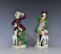 A pair of Continental figures of a huntsman and huntswoman, probably Samson, early 20th century,