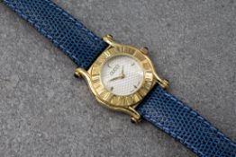 A lady's Gucci 6500L gold plated quartz wristwatch, with wave decorated silvered dial with quarter