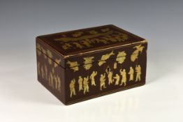 A Chinese export red lacquered tea caddy, early 19th century, the exterior decorated in gilt and