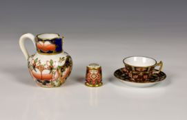 A collection of Royal Crown Derby miniatures, in the Imari palette, comprising a cup and saucer, the