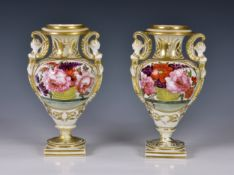 A pair of 19th century English porcelain vases, probably Spode, of classical urn form, with twin