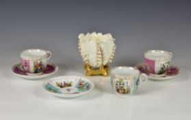Three Dresden cabinet cups & saucers, with alternating panels of romantic figures and floral