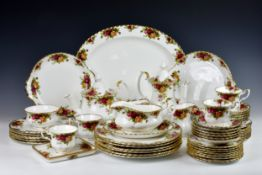 A Royal Albert Old Country Roses part dinner service, comprising a teapot, a coffee pot, six tea