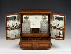 A Victorian Chapmans Patent 12481 oak-cased tantalus & games compendium, the cabinet style box
