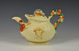 An early 20th century Clarice Cliff ' Celtic Harvest ware' teapot, embossed fruit and wheat sheaf