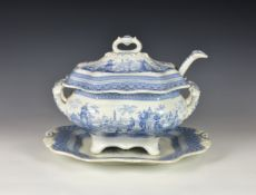 A 19th century English blue & white pottery transferware soup tureen and cover, with stand and