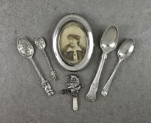 A collection of silver smalls, comprising a Mr Punch childs rattle with mother of pearl teether;