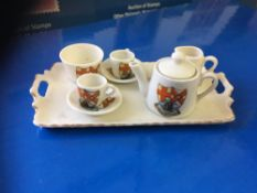 CRESTED CHINA, Tea service on tray from