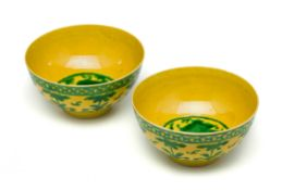 A PAIR OF CHINESE YELLOW AND GREEN 'DRAGON' BOWLS, 20TH CENTURY