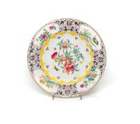 A CHINESE CANTON ENAMEL 'POMEGRANATE' PLATE, QIANLONG PERIOD (1736-95)