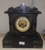 A marble and slate cased mantel clock with brass dial