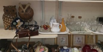 A selection of decorative items including glassware and a Paillard Bolex cine camera accessories