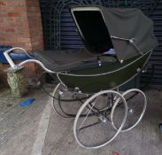 A vintage Marmet 1960's/70's coach built pram in brown