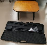 A modern gun carrying case; a coffee table